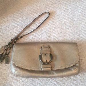Coach gold clutch handbag